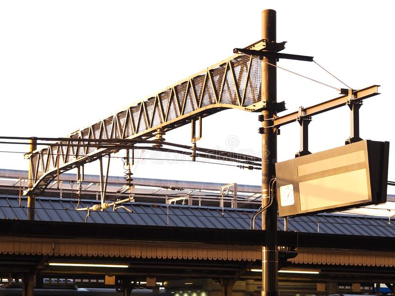 Steel structure and blank light box timetable information at train platform royalty free stock photo