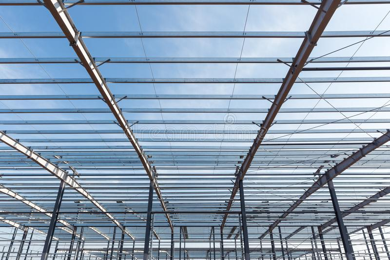 Steel structure building. Closeup against a blue sky stock photo