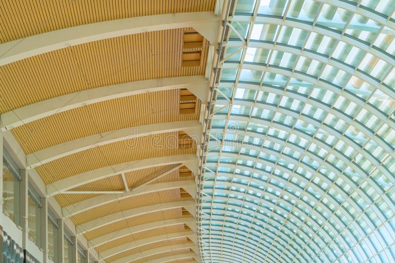Steel structure of modern office building roof. Metal windows glass facade frames supported. Abstract interior architecture design stock image