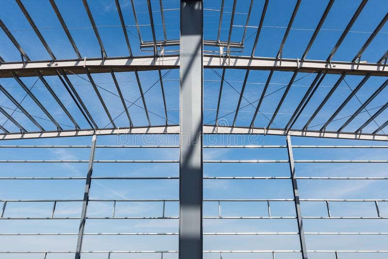 Steel structure workshop closeup. Factory buildings in construction royalty free stock image