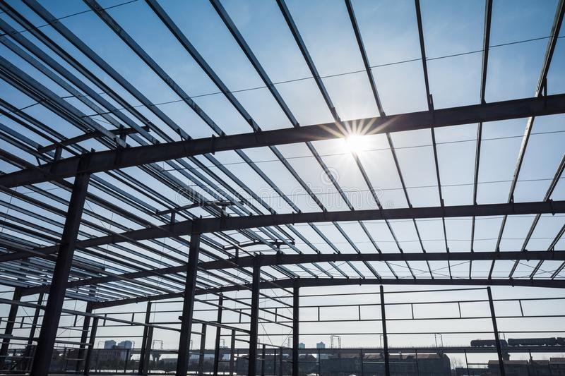 Steel structure workshop. In construction, steel frame factory building closeup royalty free stock images