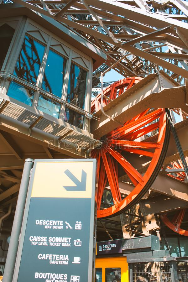 Steel structures of an elevator in the Eiffel Tower in Paris. Vertical image royalty free stock photos