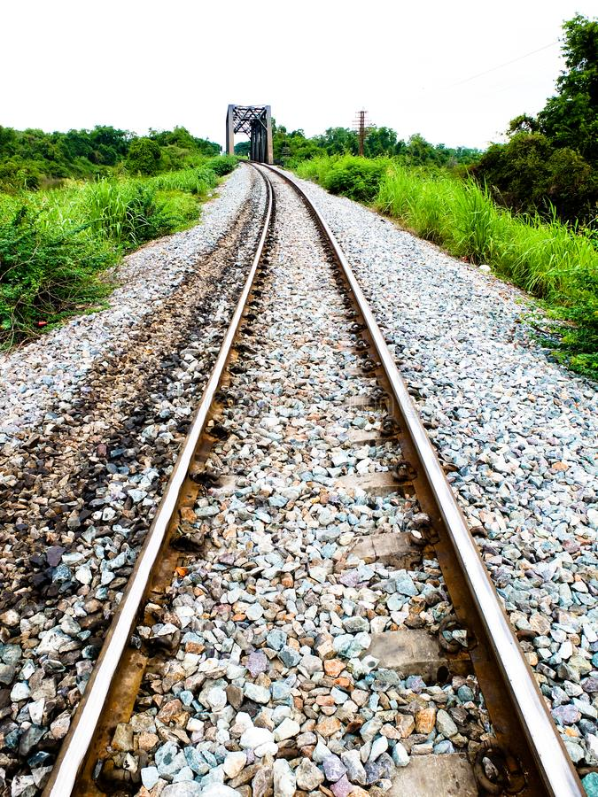 Steel support rails with concrete sleepers strewn with gravel.  stock photos