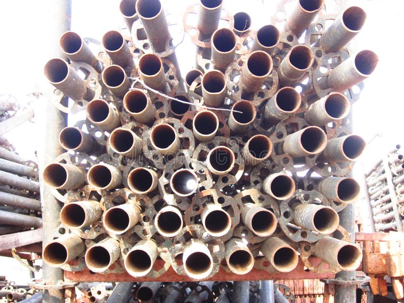 Steel supports for scaffolding racks. Steel poles for mounting scaffolding royalty free stock images
