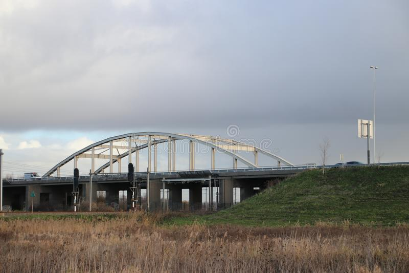 Steel suspension bridge on motorway A20 over the railroad tracks between Gouda, The Hague and Waddinxveen. stock photo
