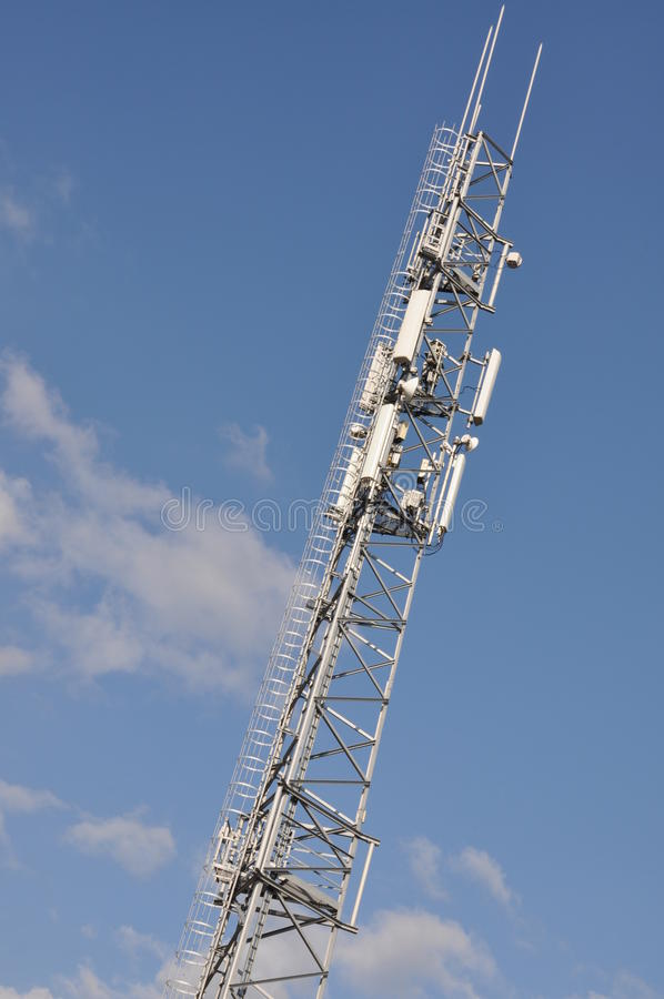 Steel telecommunication tower. With antenna system royalty free stock photography