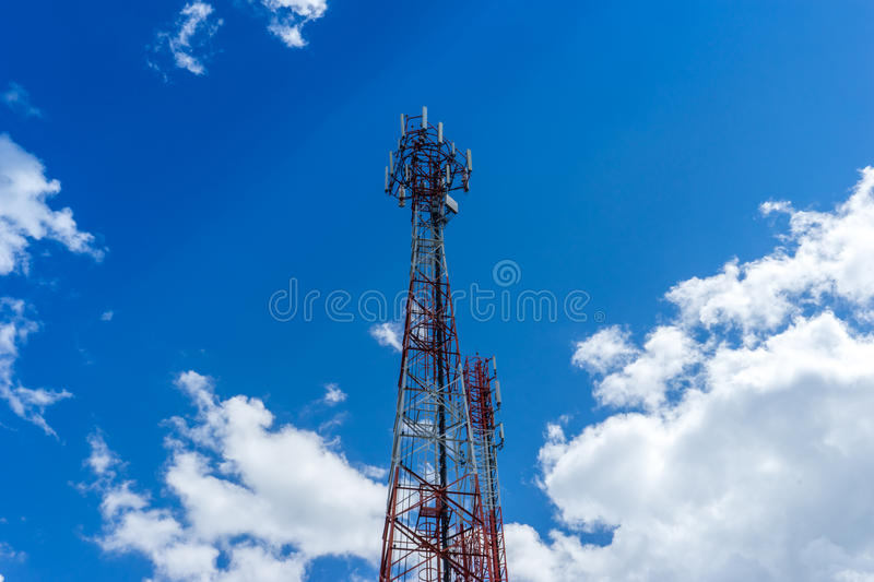 Steel telecommunication tower with antennas over blue sky 1 stock photos