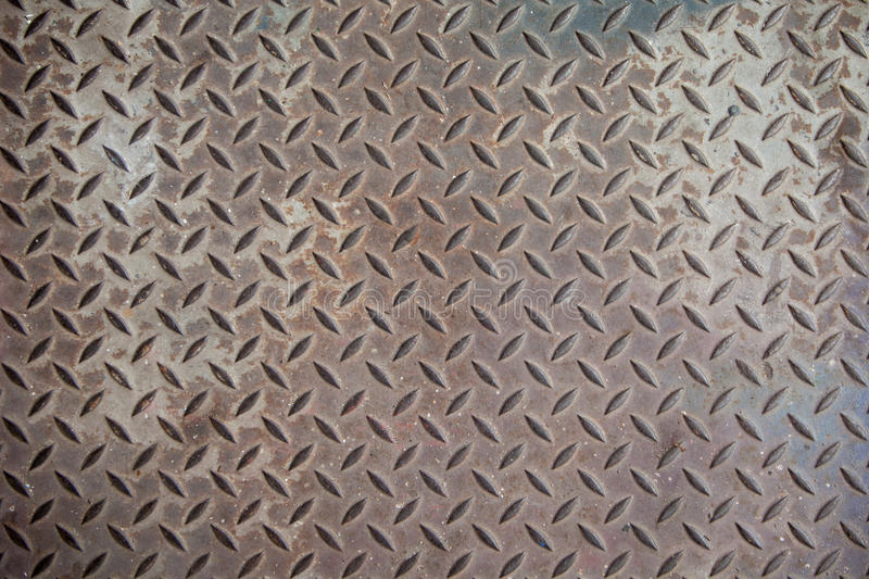 Steel texture from Manhole cover. Metallic background and wallpaper. Detail of Manhole cover pattern. stock photography