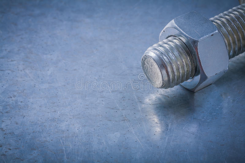 Steel threaded bolt and screw-nut on metallic background constru. Ction concept royalty free stock photos