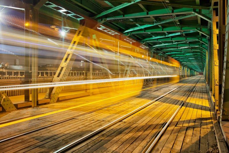 Steel Truss Bridge with Tram Light Trail stock photo