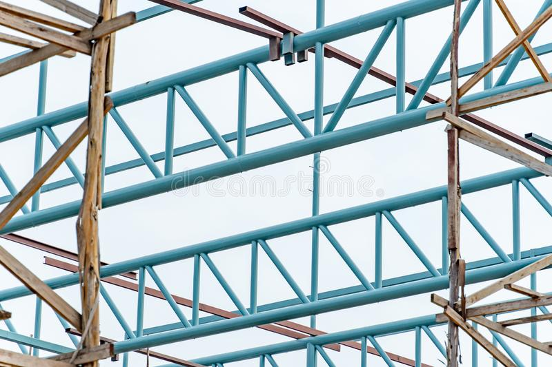 Steel truss structure and wooden scaffolding. Steel truss structure with wooden scaffolding at construction site. Structural engineering concept royalty free stock photo