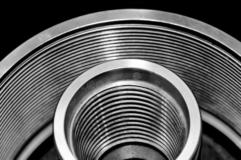 Steel tubes, cylinders with a thread. Black and white tone stock images