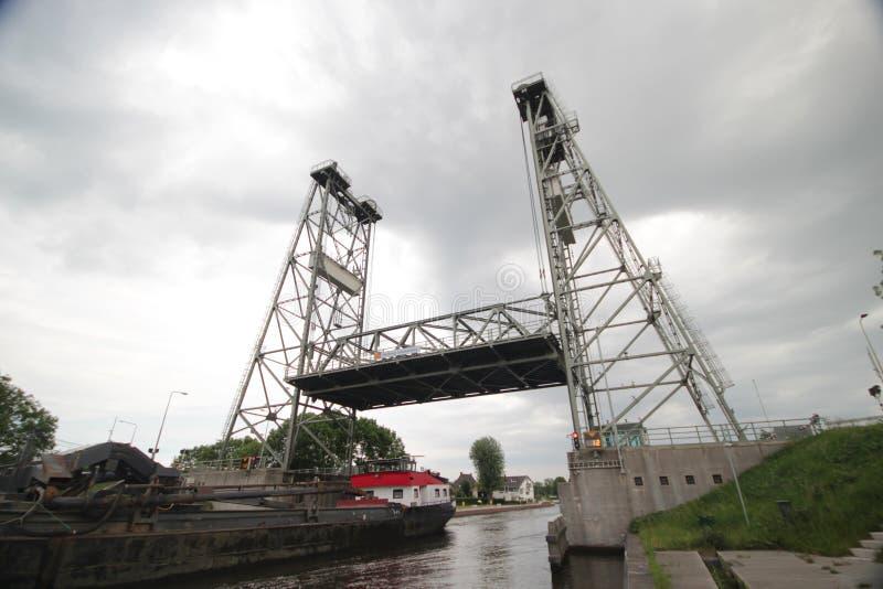Steel vertical lift bridge in Alphen aan den Rijn over the canal Gouwe. royalty free stock image