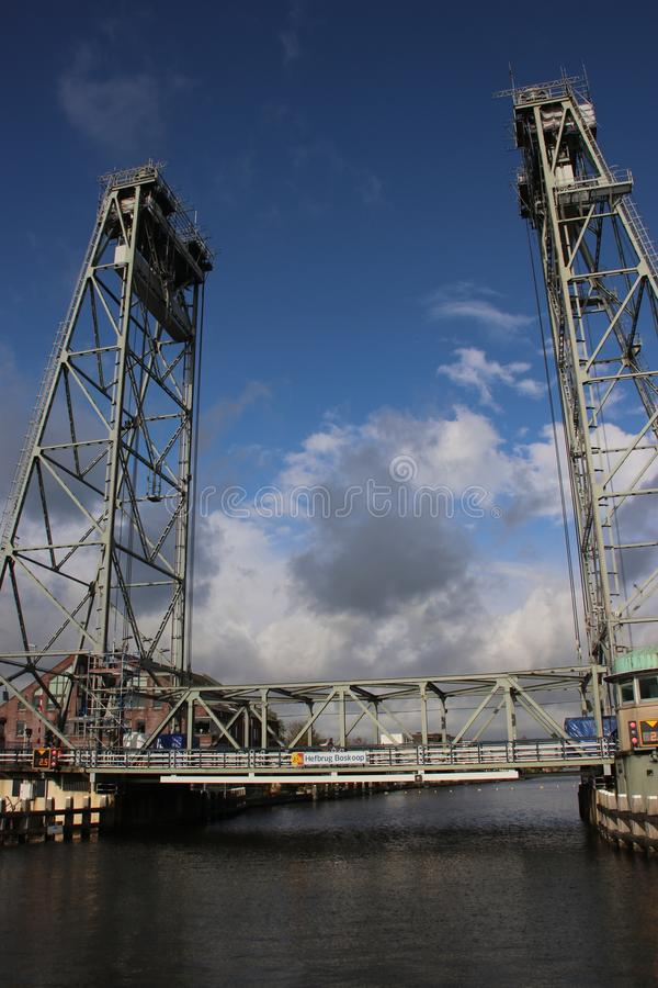Steel vertical lift bridge in Boskoop over river Gouda during maintenance royalty free stock images