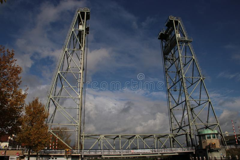 Steel vertical lifting bridge named Hefbrug Waddinxveen over river Gouwe between Alphen and Gouda in the Netherlands royalty free stock photos