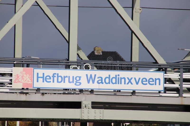 Steel vertical lifting bridge named Hefbrug Waddinxveen over river Gouwe between Alphen and Gouda in the Netherlands stock image