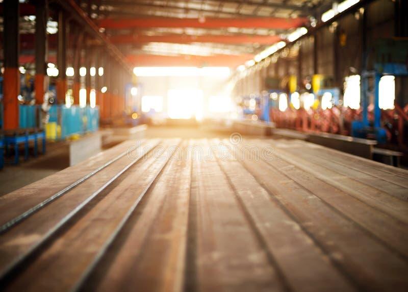Steel warehouse. Steel factory floor and a lot of steel stock photos