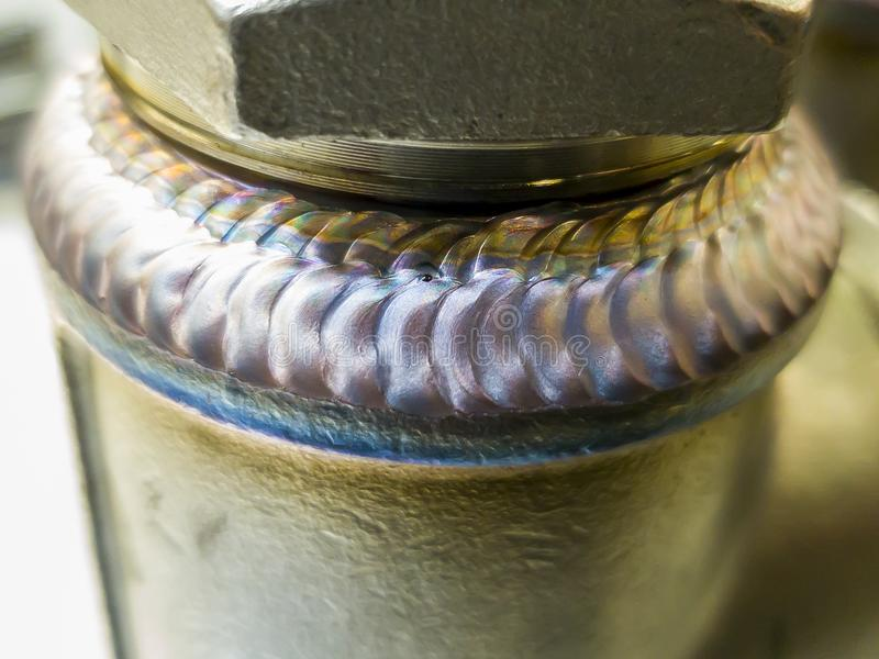 Steel weld joined pipe to plate by arc welding process. Weld. Steel weld joined pipe to plate by arc welding process . rainbow color.with copy space Weld royalty free stock photos