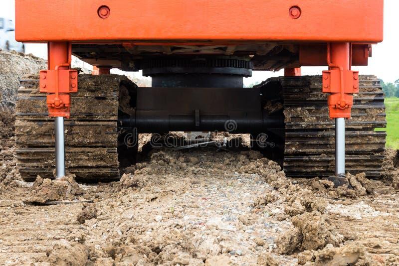 Steel Wheels backhoe braced ground. royalty free stock image