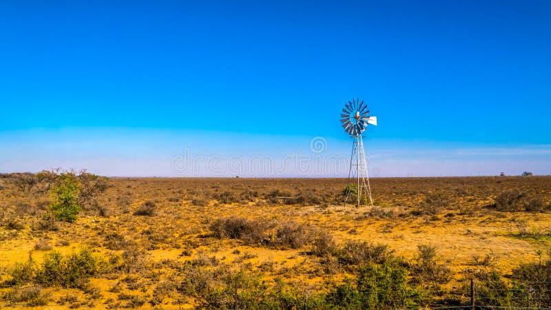 Steel Windpump in the semi desert Karoo region in South Africa. Steel Windpump in the dry semi desert Karoo region in South Africa stock photo