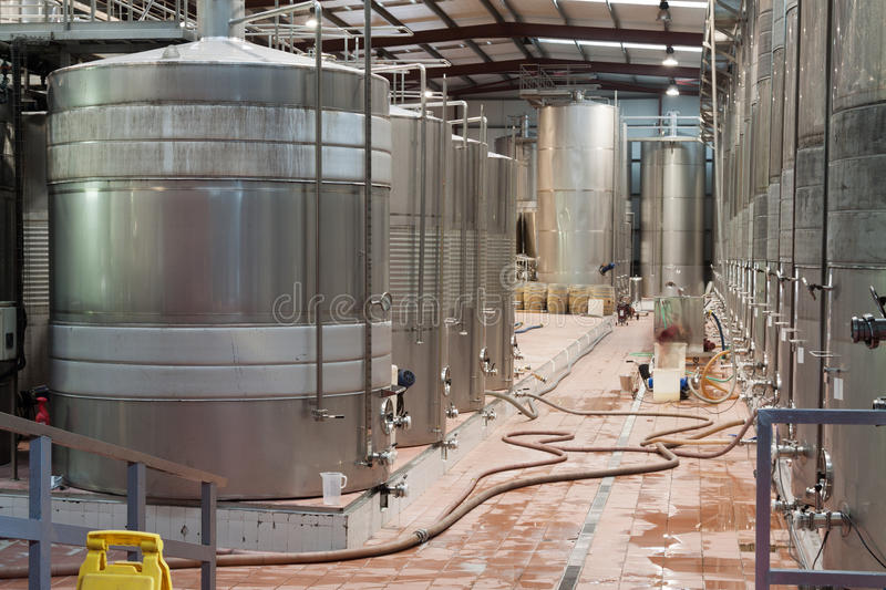 Steel wine reservoirs in row inside the winery factory stock image