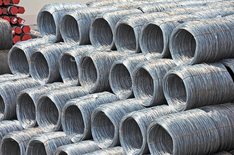 Steel wire roll and pipe. Stacked steel wire roll and pipe, ready for shipment in port royalty free stock photo