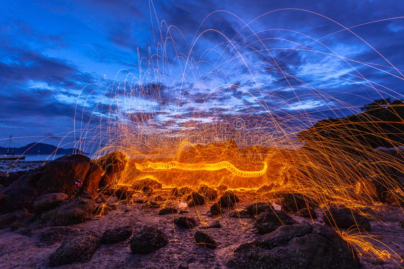 steel wool fire work on the rock royalty free stock photography