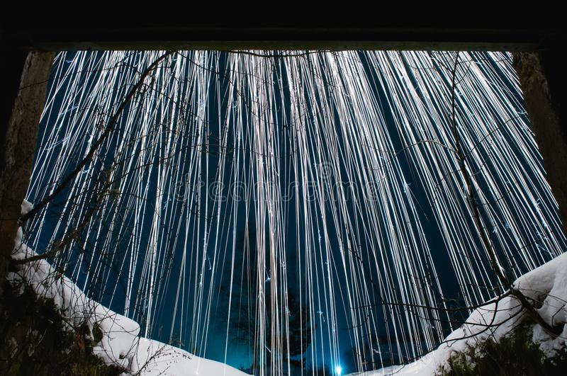 Steel wool photo. silver sparks. white sparks on the night blue sky. white snow. royalty free stock image