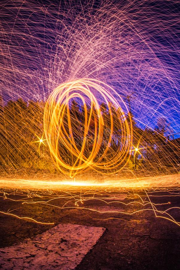 Steel wool photograph at night, long exposure photography workshop royalty free stock images