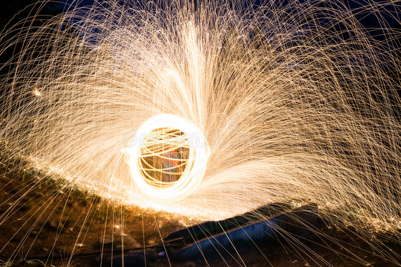 Steel wool sparks stock photo