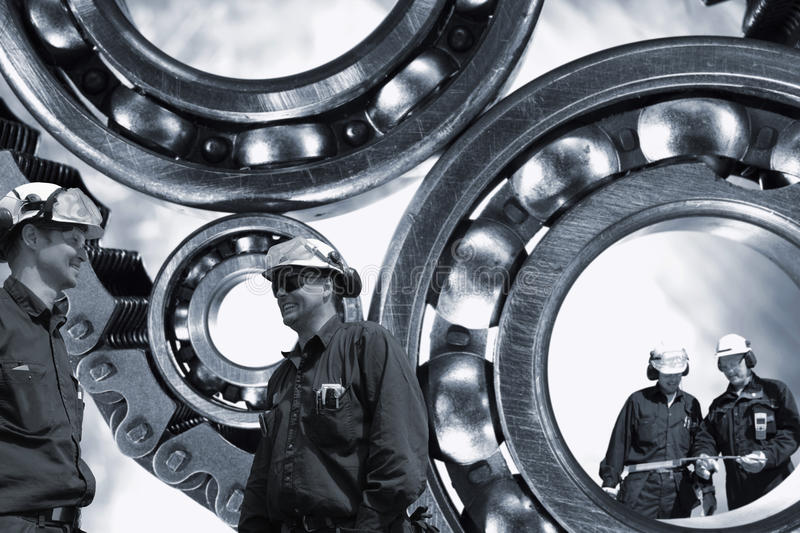 Steel-workers with gears and bearings royalty free stock photo