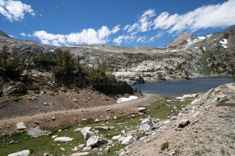 Steelhead Lake in the 20 Lakes Basin area of California, along a hiking trail on a summer day in the Sierra Nevada Mountains. During daytime stock photography