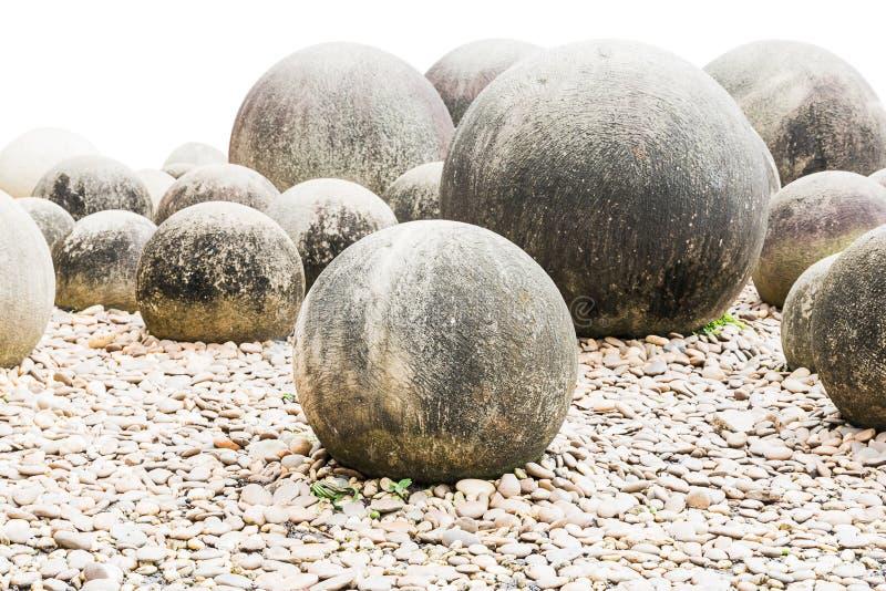Steen in Japanse tuin op wit stock afbeeldingen