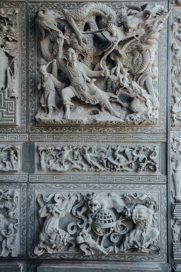 Steen snijdende muur die over Chinese sprookjes, in Chinese tempel in George Town vertelde Penang, Maleisië royalty-vrije stock afbeeldingen
