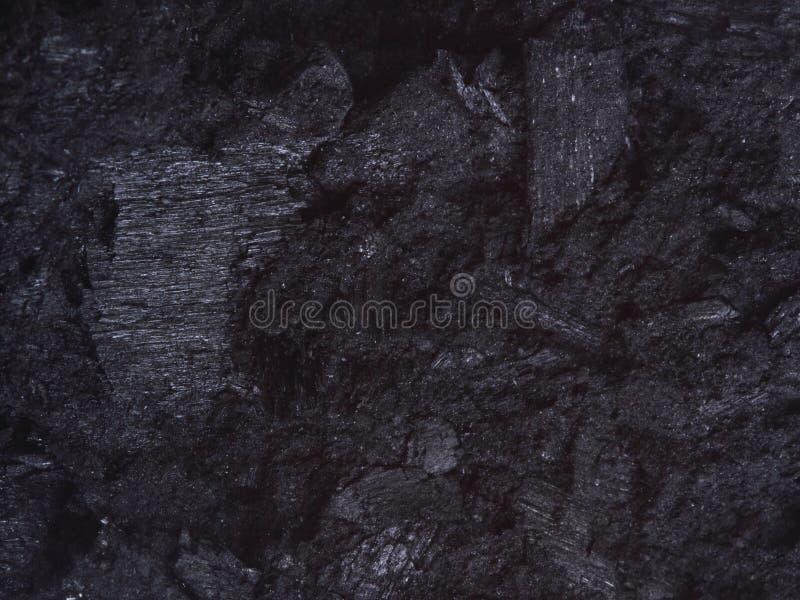 Steenkool, van achtergrond koolstofgoudklompjes textuurzwarte stock foto
