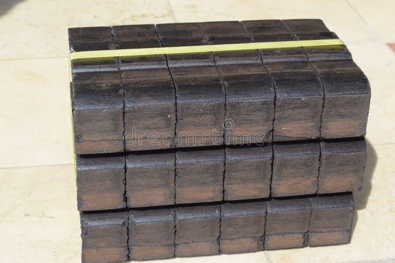 Steenkoolbriket, het blok van de steenkoolbriket, de blokken van de steenkoolbriket, stapel van steenkoolbriketten, de brikettenb royalty-vrije stock foto