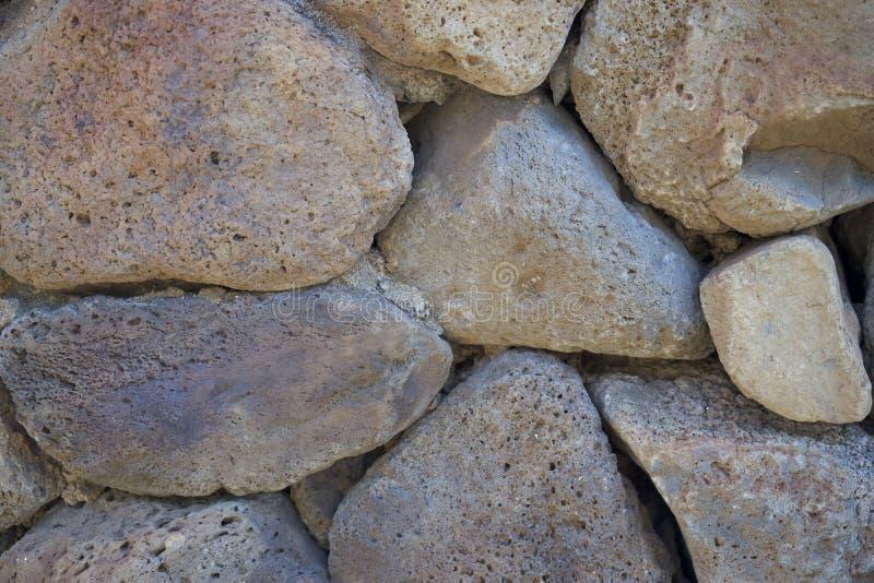Steenmuur van Vulkanische Rots wordt gemaakt die royalty-vrije stock afbeelding