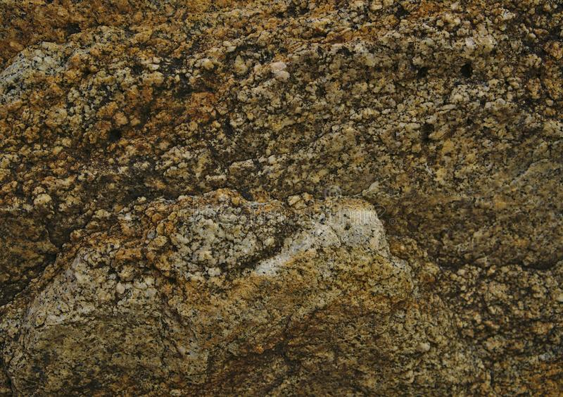 Steentextuur in bruine en grijze kleur stock afbeelding