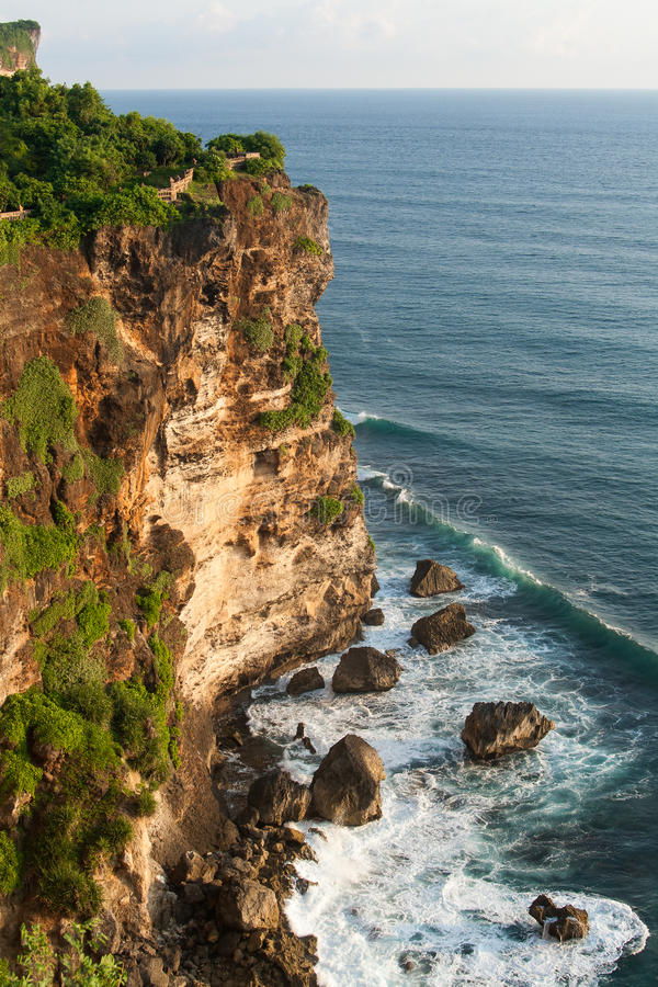 Steep cliff at Bali. Steep cliff meets the ocean at Uluwatu, Bali, Indonesia royalty free stock photos