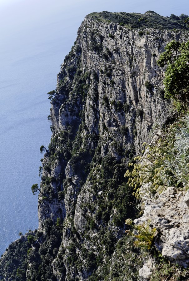Steep Cliff Capri. A steep cliff on Monte Solaro on the top of the Island of Capri and the Mediterranean sea. South of Italy royalty free stock photo