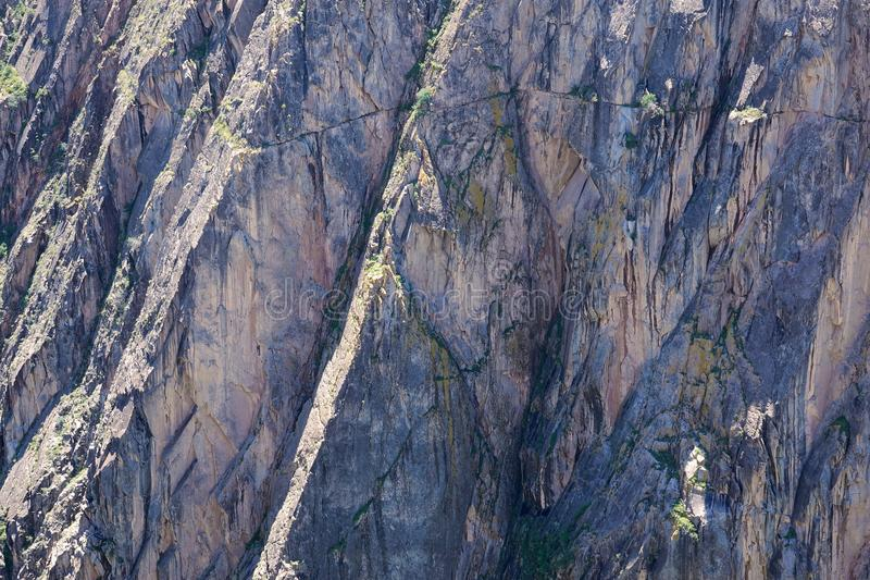 Steep cliff. The close-up of steep rock cliff stock photography