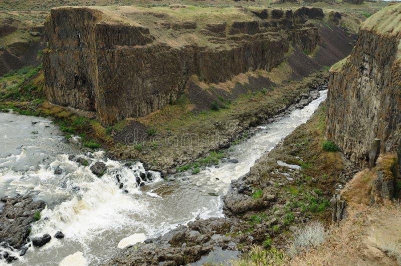 Steep cliff to canyon stock photos