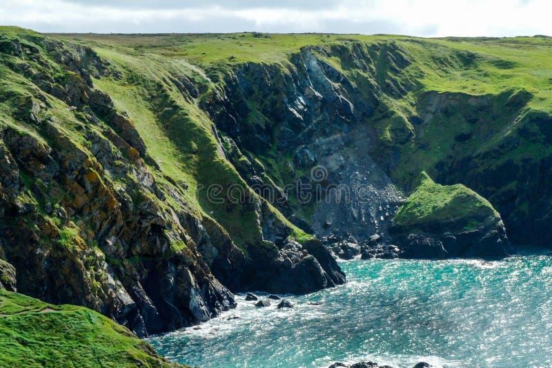 Steep cliffs around Mullion Cove, Cornwall. Showing coastal erosion royalty free stock photos