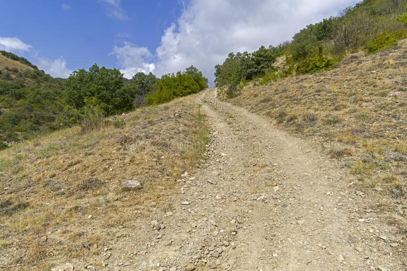 Steep descent on a dirt road. royalty free stock image