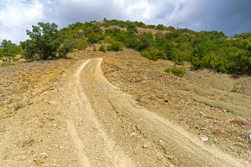 Steep descent on a dirt road. Crimean mountains royalty free stock photos