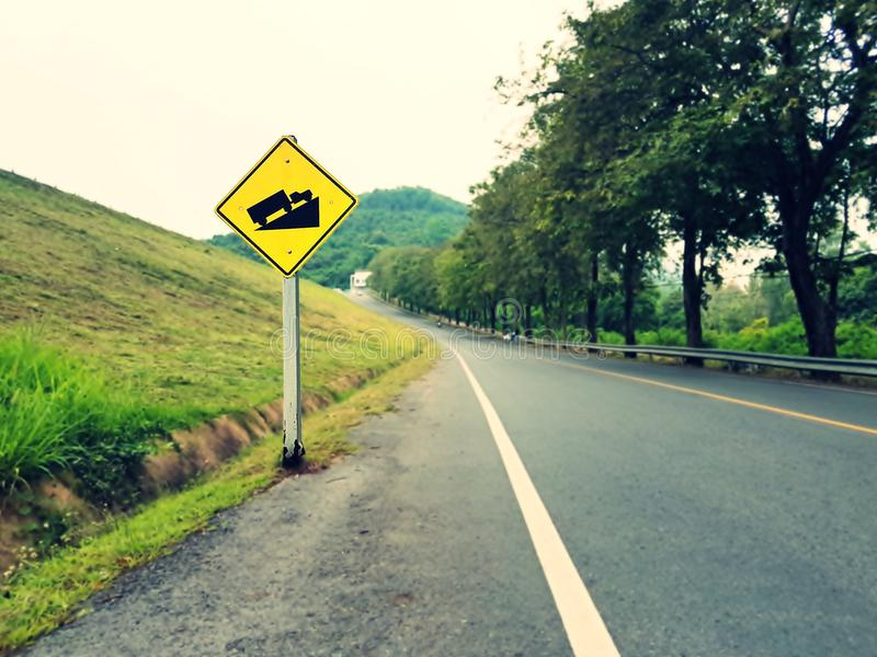 Steep grade hill traffic sign on road. Steep grade hill traffic sign on road near the dam stock photo
