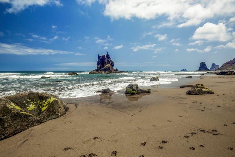 Steep high lava rock cliffs. Blue sea horizon, natural sky background royalty free stock photo