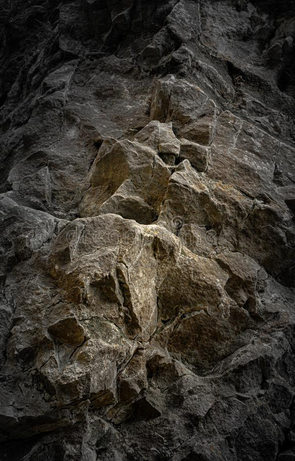 Steep rocky cliff with warm accent. Steep, old rocky cliff with warm accent in the Carpathian Mountains royalty free stock photos