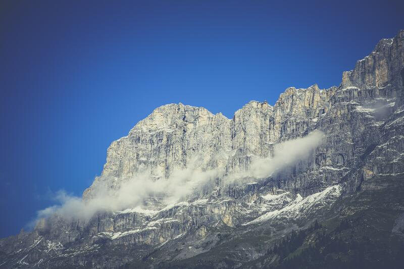 Steep rocky cliff stock image
