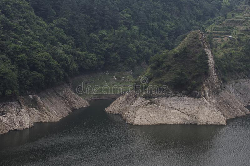 Steep Rocky Shoreline. A steep rocky shoreline of a lake in nepal royalty free stock photo